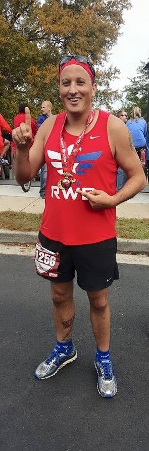 Mike Goranson poses for a picture after finishing the Marine Corps Marathon in Washington, D.C.