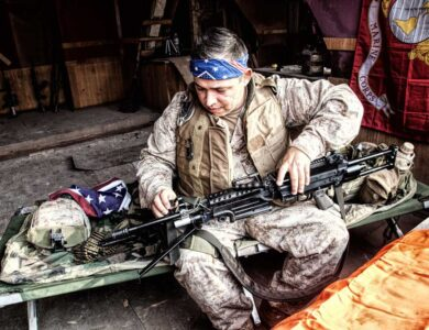 Marine Corps machine gunner, wearing Confederate flag bandana, checking gun barrel. (Adobe Stock)