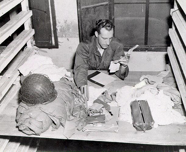 3 Soldiers' Personal effects being checked at a collection point