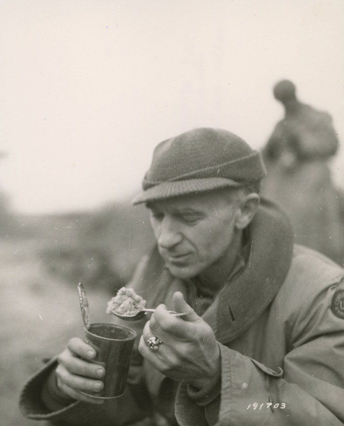 Ernie Pyle eating C rations Anzio Beachhead area Italy, March 18 1944
