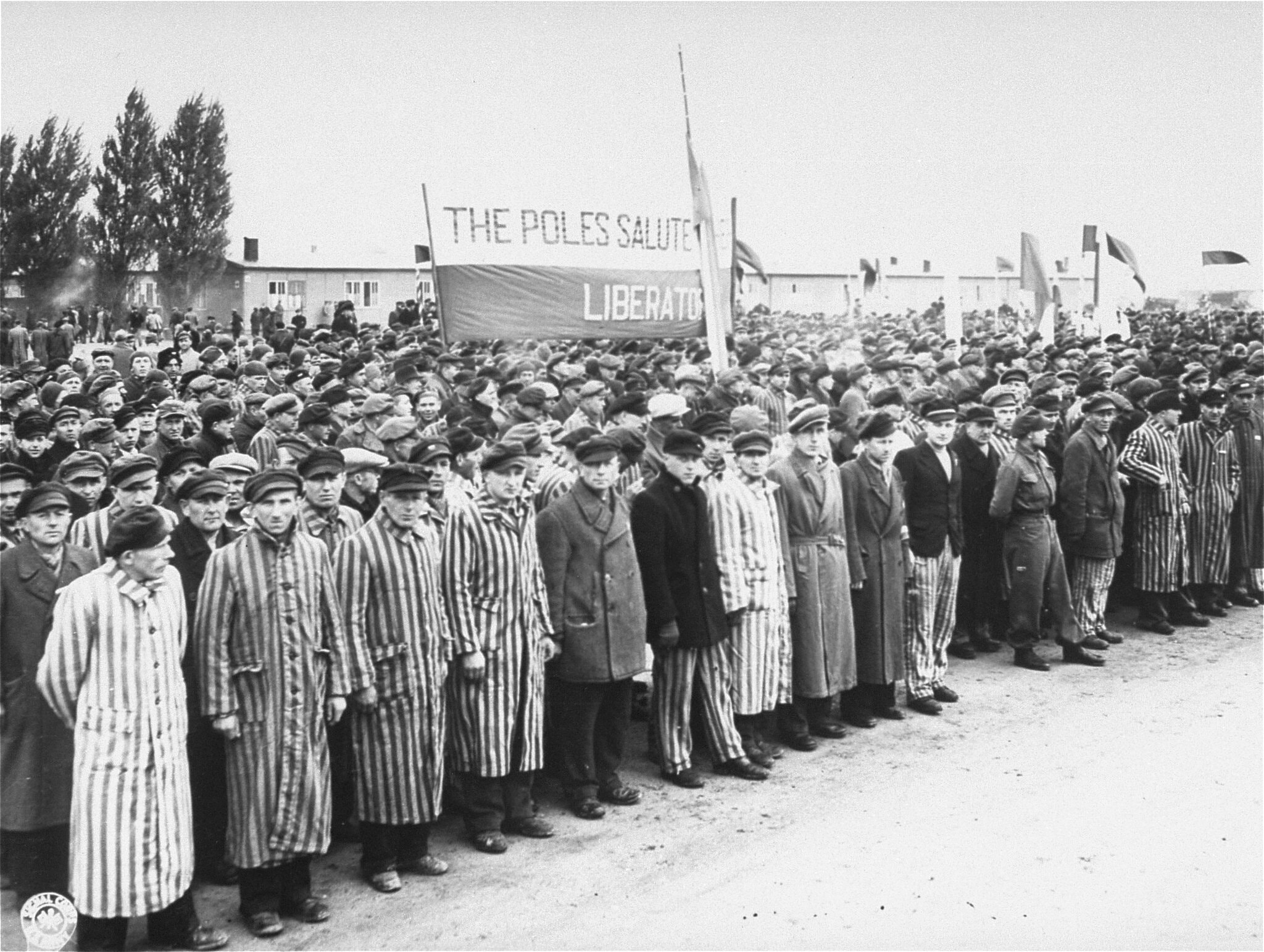 Survivors gather on May 3, 1945, to salute the Allies and to remember people who perished in Dachau.Credit...United States Holocaust Memorial Museum, Courtesy of National Archives and Records Administration, College Park