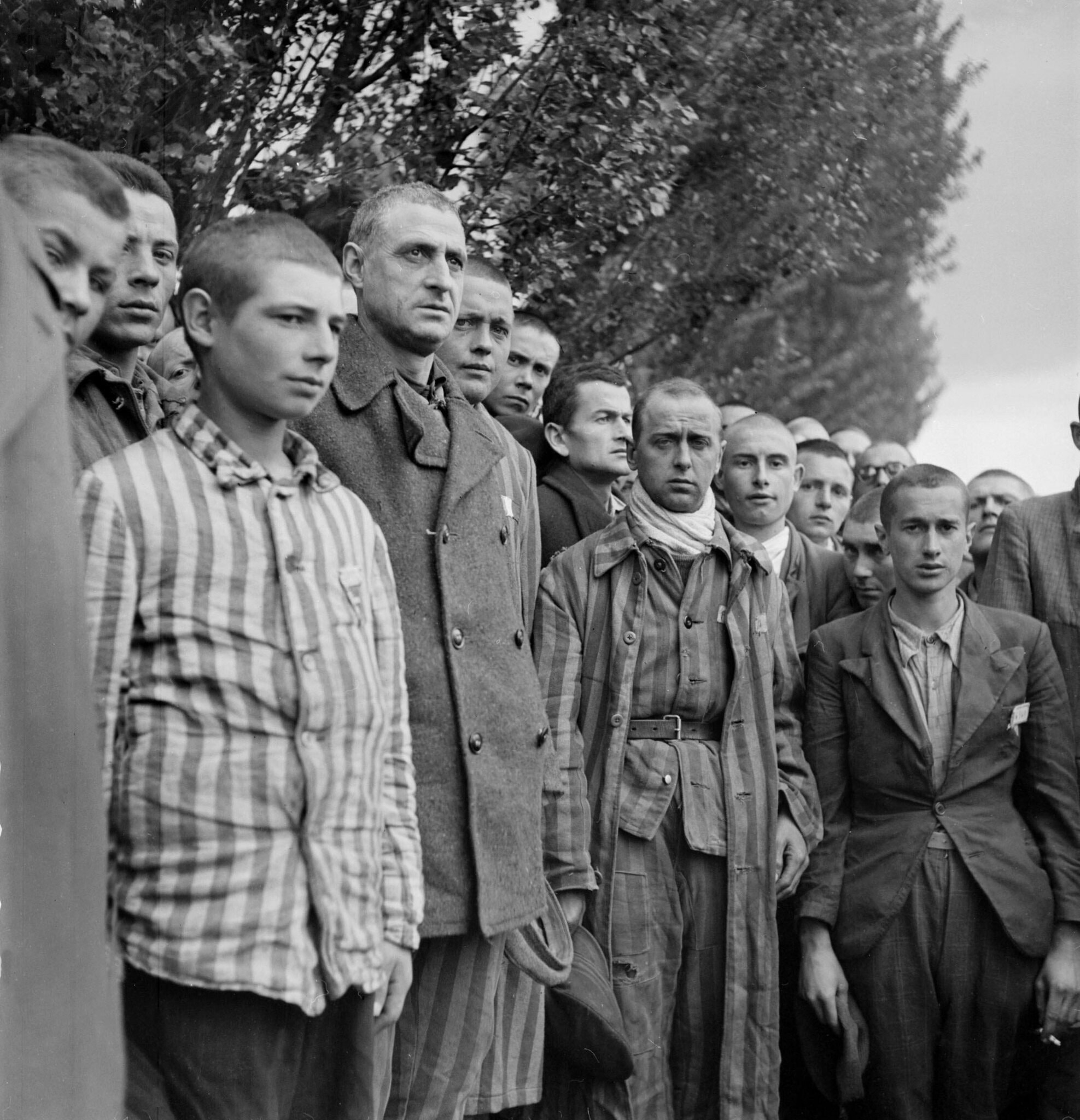 Prisoners observe a moment of silence on April 29, 1945, following the liberation by Allied troops of Dachau.Credit...Eric Schwab/Agence France-Presse — Getty Images